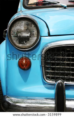 Close-up of the front of an old blue car - stock photo