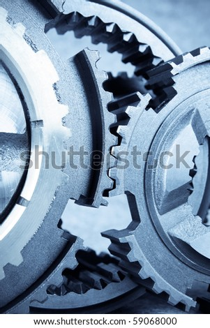 close up of the gears meshing together - stock photo