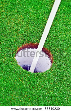 Close up of the hole on the golf course - stock photo