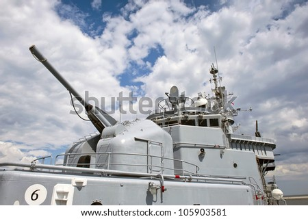 Close-up of the huge cannon. View from the bow of main deck the battleship. - stock photo