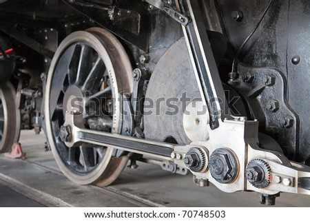 Close-up of the huge train wheels in the museum - stock photo