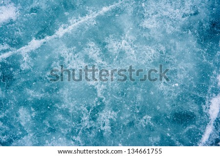 close up of the ice of a clear frozen lake - stock photo
