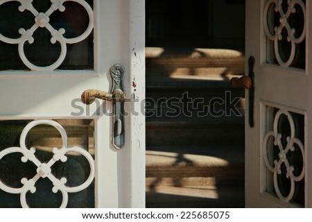 Close up of the iron door handle on the old wooden door  - stock photo