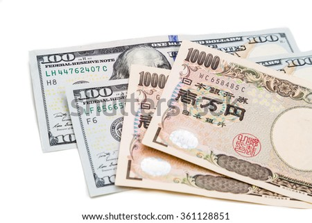 Close up of the Japanese Yen currency note against US Dollar on white background - stock photo