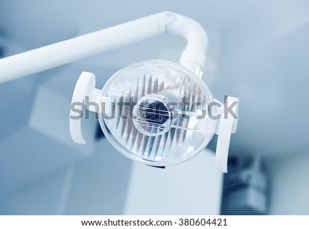Close-up of the lamp in dental clinic. Interior of dentist office. Health care and medicine.   - stock photo