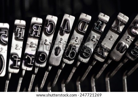 Close up of the letters on an old typewriter - stock photo