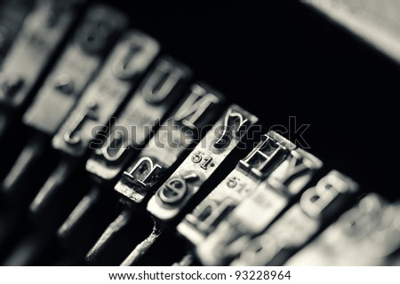 Close up of the letters on an old typewriter. - stock photo