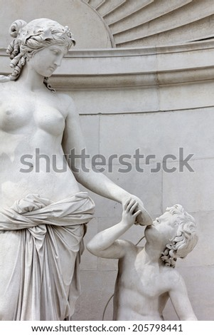 Close-up of the Marble Statue of Tethys on the Facade of the Lloyd Palace in Trieste, Italy - stock photo
