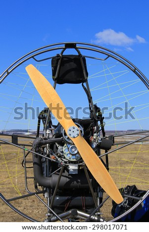 close-up of the motor glider on the ground in the early spring and the pilot is ready to fly