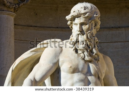 Close up of the Neptune statue of the Trevi Fountain in Rome, Italy. - stock photo