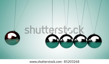 close up of the Newton's cradle, particularly of the spheres - stock photo