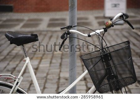 Close-up of the old bicycle with rain drops. - stock photo
