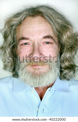 close-up of the old man's gray grandfather with long curly hair beard and mustache smiles