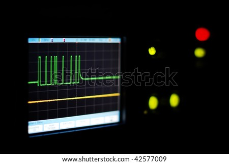 Close-up of the oscilloscope screen in the dark - stock photo