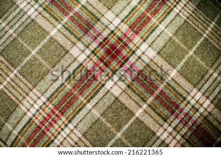Close up of the pattern of a tartan wool - stock photo