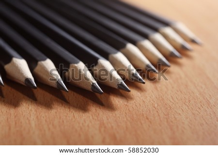 close up of the pencil in a row