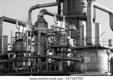 Close-up of the pipes and tubes of an oil-refinery plant - stock photo