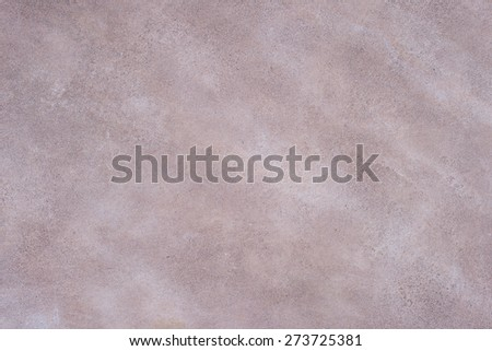 Close up of the plastered surface of an coarse marsala painted wall with scratches and spots. Pastel tone for background. Grunge or vintage style. - stock photo