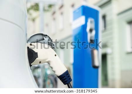 Close-up Of The Power Supply Cable For Charging An Electric Car - stock photo