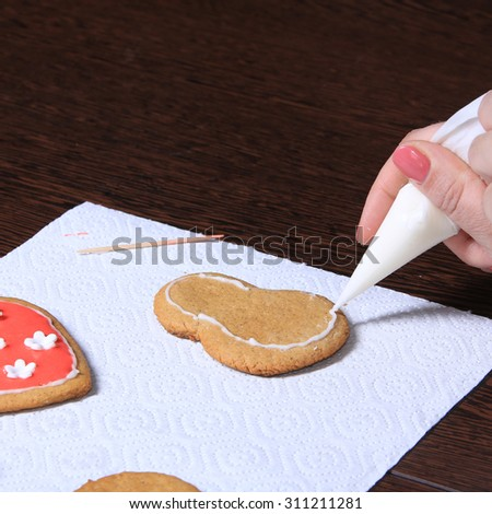 close-up of the process of hand-painted ginger cookies