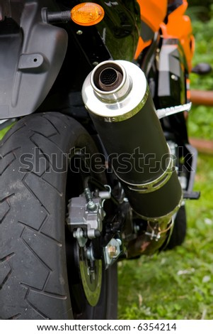 Close up of the rear wheel of a motorcycle - stock photo