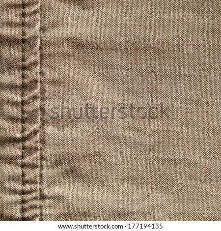 Close up of the seam on a khaki color garment - stock photo