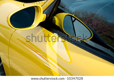 Close up of the side mirror on a Porsche GT3 - stock photo
