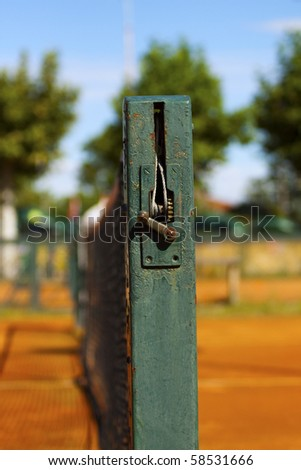 Close up of the side of a tennis net on a clay court - stock photo