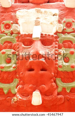 Close up of the sun god face on the replica of the Rosalila Temple at the ancient Mayan ruins of Copan, Honduras, Central America. - stock photo