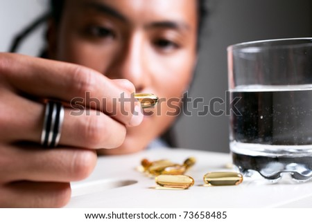 Close up of the supplement pill. - stock photo