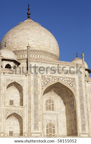 Close up of the Taj Mahal dome and archway. - stock photo