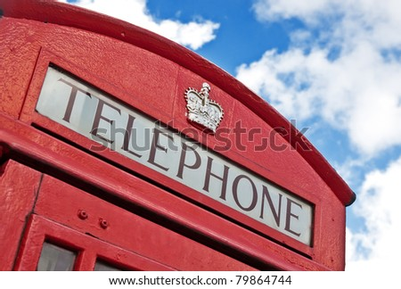 Close up of the top of a classic red London Telephone box, on Trafalgar Square in London, England, Great Britain - stock photo