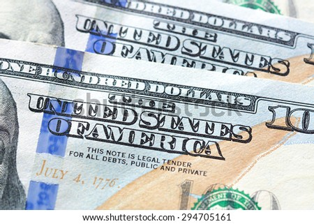 Close up of THE UNITED STATES OF AMERICA text on 100 US dollar bill (banknote)