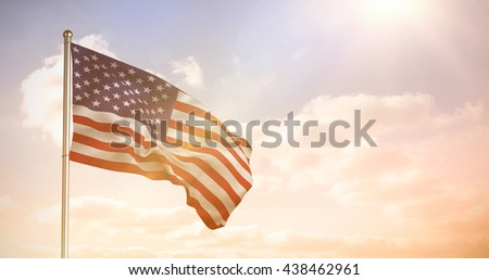 Close up of the us flag against colored sky with clouds - stock photo