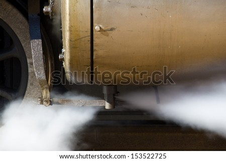 Close up of the vessel where pressure builds up and releasing some of the steam pressure - stock photo