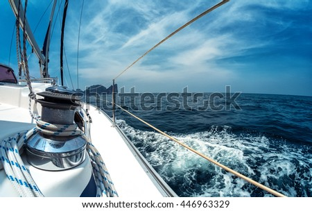 Close up of the winch on the sailing vessel moving in the sea - stock photo