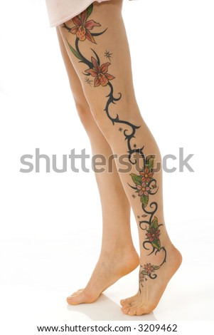 close up of the woman legs with a flower tattoo - stock photo