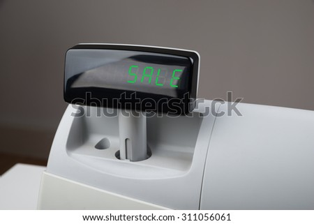 Close-up Of The Word Sale On Digital Display Of Cash Register - stock photo