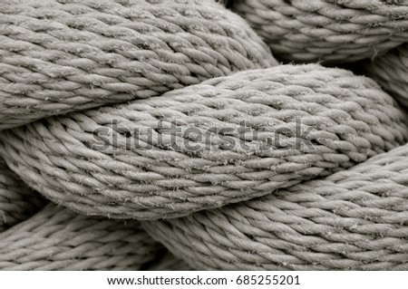 Close up of thick heavy duty rope showing detail of threads and fibres