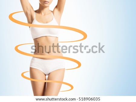 Close-up of thin and beautiful female body. Weight loss, sports, exercising, tan, sun burn concept.