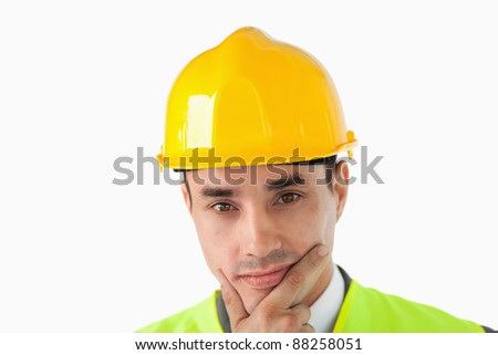Close up of thinking architect against a white background