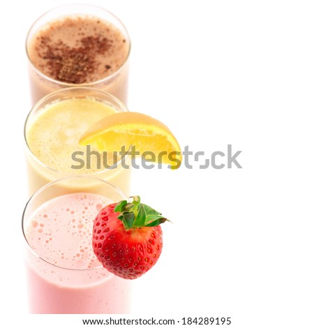 Close-up of three assorted protein cocktails on white background. - stock photo