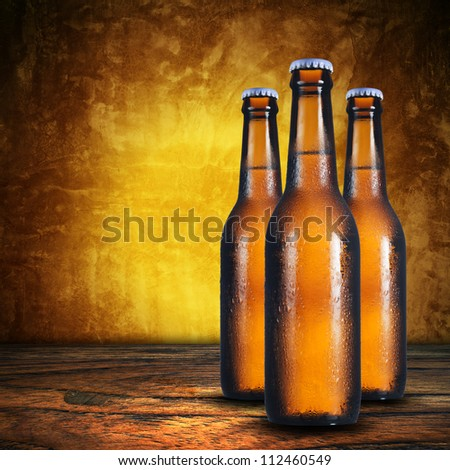 Close up of three beer bottles. Cold refreshment - stock photo
