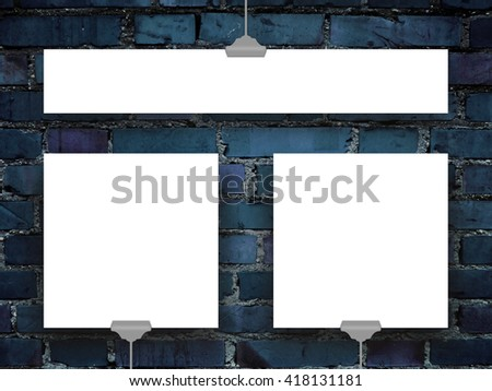 Close-up of three blank square and rectangular frames hanged by clips against blue brick wall background
