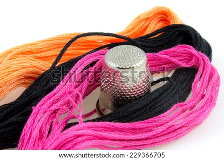 close up of three colored cotton threads - stock photo