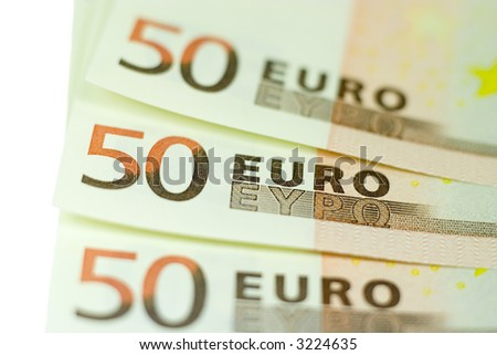 Close-up of three 50 Euro bills with shallow depth of field isolated on a white background
