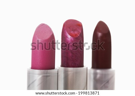Close up of three lipsticks