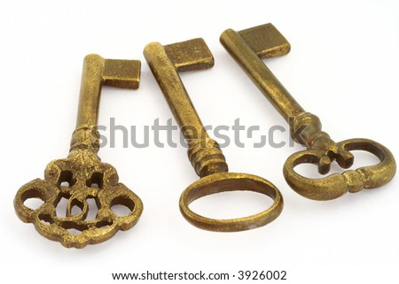 close-up of three ornamented old keys isolated on white background - stock photo