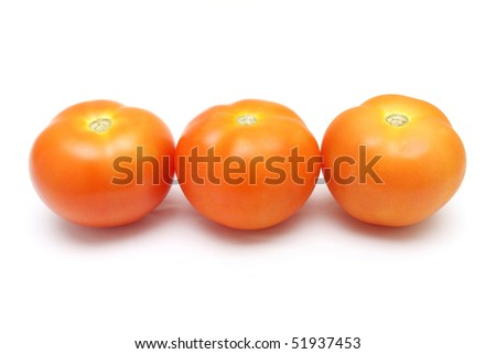 Close up of three tomatoes isolated on white background.