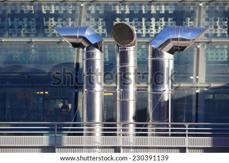 close up of three ventilation chimneys in stainless steel - stock photo